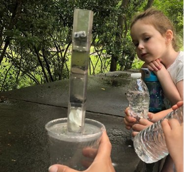 young girl learning science