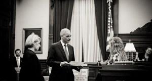 Former Attorney General Eric Holder with U.S. District Court Judge Bruce Hendricks and a BRIDGE participant. Photo courtesy Hendricks.