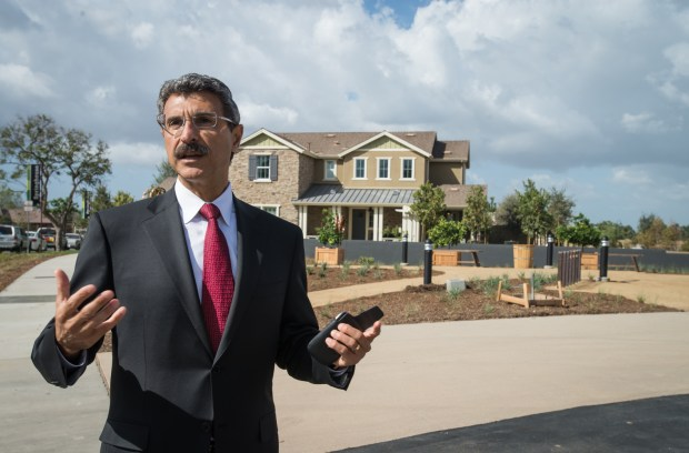 CEO of FivePoint Communities, Emile Haddad, leads a tour through new homes and answers questions during the unveiling of Pavilion Park.