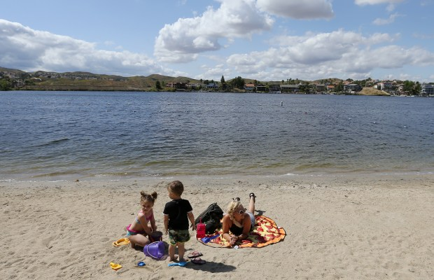 Ashlyn Holcomb and her kids Braelyn ,4, and Lukas, 2 enjoy the sand and weather in Canyon Lake Thursday, Apr.13, 2017. FRANK BELLINO, THE PRESS-ENTERPRISE/SCNG