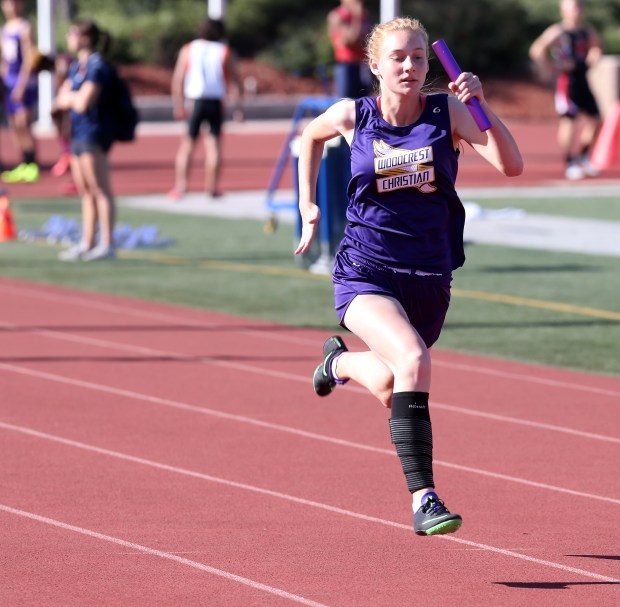 Woodcrest Christian's Ella Whitehouse leads the pack to help wins the Girls 4x100 meter relay small schools finals during the Raincross Tradition/Riverside City Championship High School Track & Field meet at King High School in Riverside Saturday, Apr.15, 2017. FRANK BELLINO, THE PRESS-ENTERPRISE/SCNG