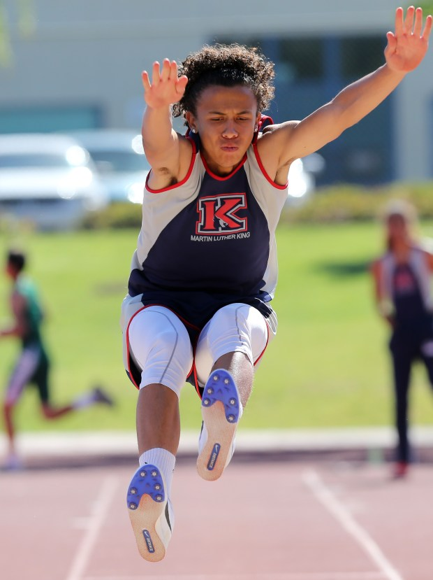 King's Trey Anderson competes in the boys long jump during the Raincross Tradition/Riverside City Championship High School Track & Field meet at King High School in Riverside Saturday, Apr.15, 2017. FRANK BELLINO, THE PRESS-ENTERPRISE/SCNG