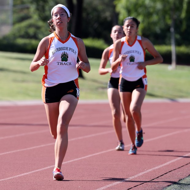 Riverside Poly's Marina Kaye leads the pack during the girls 1 mile run at the Raincross Tradition/Riverside City Championship High School Track & Field meet at King High School in Riverside Saturday, Apr.15, 2017. FRANK BELLINO, THE PRESS-ENTERPRISE/SCNG