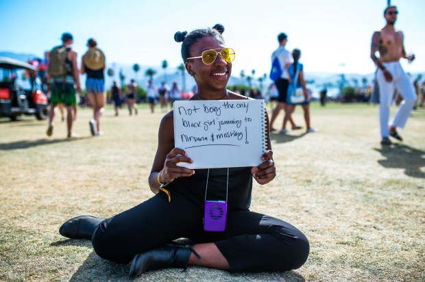 "Shaqueal Adkins, 27, of Watts, was stoked to hear some Nirvana at her very first Coachella Valley Music and Arts Festival on Sunday, April 16, 2017. ""This is a little exhausting,"" she said about braving the festival's three days of music, fun and heat. (Photo by Watchara Phomicinda, The Press-Enterprise/SCNG)"