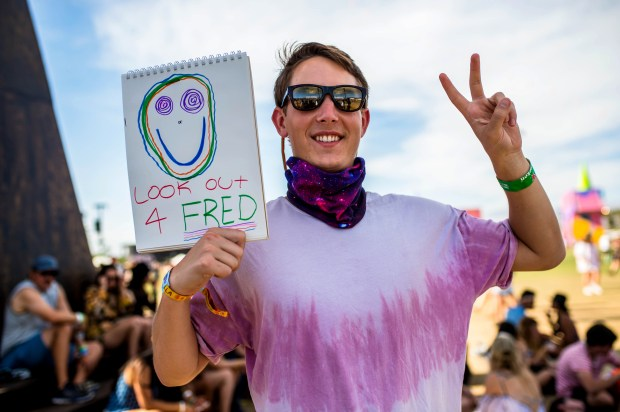 "Cooper Guthrie, 21, of Westport, Connecticut, attended his first Coachella Valley Music and Arts Festival. Fred, by the way, is a green alien he and his group of friends look for to find each other at the festival. ""This is the most unbelievable place in the world."" (Photo by Watchara Phomicinda, The Press-Enterprise/SCNG)"