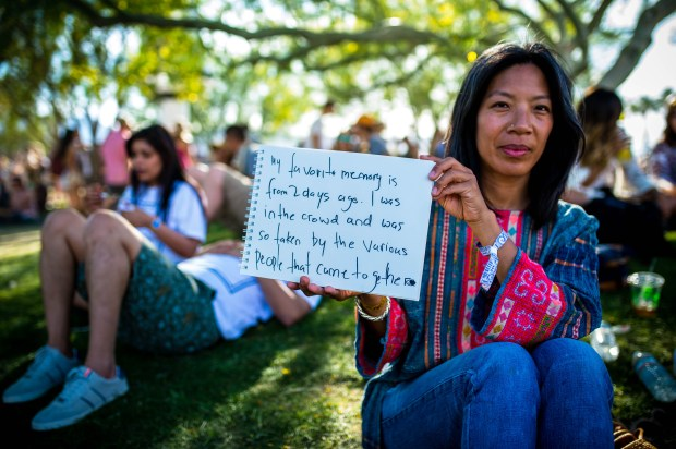"Xia Tio, 41, of Los Angeles, came to the festival specifically to see Radiohead. Despite the band's sound issues, she loved their set and was happy to see them overcome them. ""It takes a lot of guts to go through."" It was her first Coachella Valley Music and Arts Festival and said she would come back depending on who was playing. (Photo by Watchara Phomicinda, The Press-Enterprise/SCNG)"