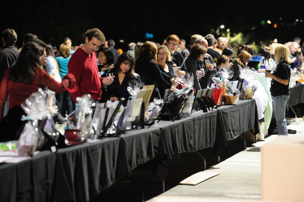 Dozens of Aliso Niguel High School supporters bid on a variety of items and services to help support programs at Aliso Niguel in 2011.