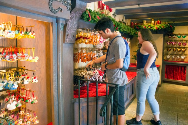 Visitors check out the merchandise in the Castle Holiday Shoppe in Fantasyland at Disneyland. Disneyland Resort officials said the new shop is a permanent addition. (Photo by Mark Eades, Orange County Register/SCNG)