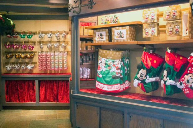 Some of the holiday-themed merchandise available in the Castle Holiday Shoppe in Fantasyland at Disneyland. Disneyland Resort officials said the new shop is a permanent addition, and that the merchandise offered would periodically change with the seasons. (Photo by Mark Eades, Orange County Register/SCNG)