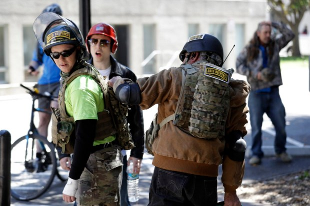 Demonstrators gear up for potential street battles Thursday, April 27, 2017, in Berkeley, Calif. Demonstrators gathered near the University of California, Berkeley campus amid a strong police presence and rallied to show support for free speech and condemn the views of Ann Coulter and her supporters. (AP Photo/Marcio Jose Sanchez) ORG XMIT: CAMS105