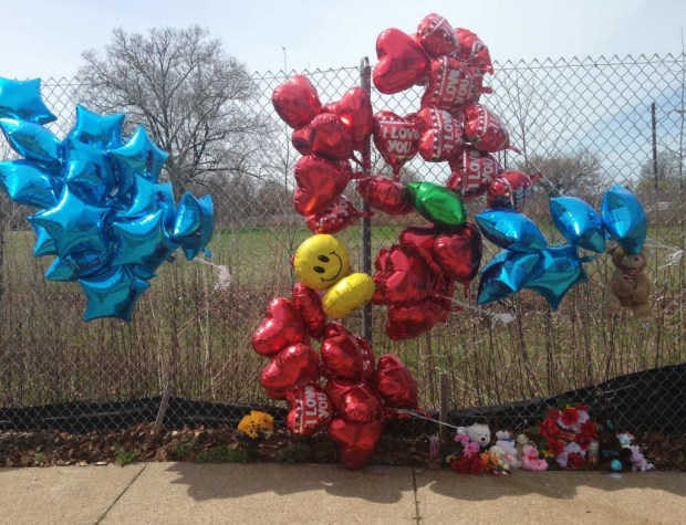 A makeshift memorial sits along a fence Monday, April 17, 2017, near where Robert Godwin Sr., was killed in Cleveland. Police said Steve Stephens killed Godwin on Sunday and posted the video on Facebook. (AP Photo/Mike Householder) ORG XMIT: RPMH201
