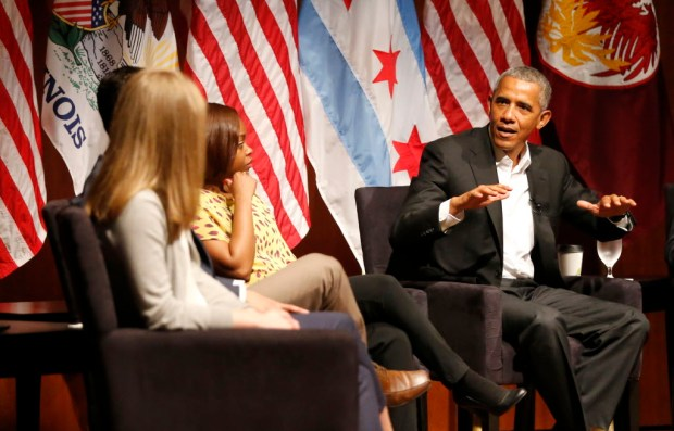 Former President Barack Obama hosts a conversation on civic engagement and community organizing, Monday, April 24, 2017, at the University of Chicago in Chicago. It's the former president's first public event of his post-presidential life in the place where he started his political career. (AP Photo/Charles Rex Arbogast) ORG XMIT: ILCA109