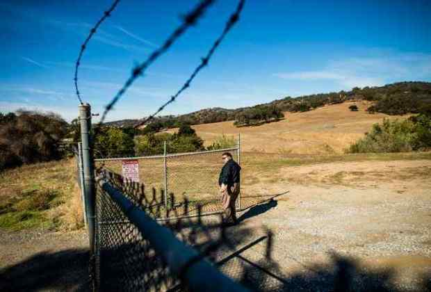 Alex Gonzalez, director of administrative services for City of Industry, opens the gate from Toner Canyon to Tres Hermanos Ranch, a 2,450-acre preserve owned by City of Industry, in Diamond Bar and Chino Hills on Nov. 7, 2016,. The sale of the land is being challenged. (Photo by Watchara Phomicinda, San Gabriel Valley Tribune/ SCNG)