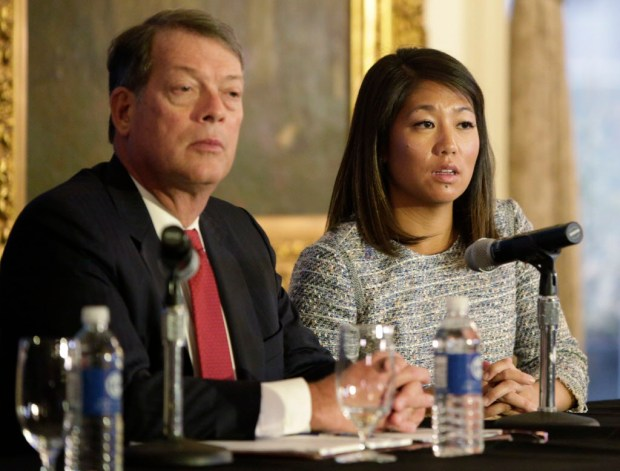 "Crystal Pepper daughter of Dr. David Dao accompanied by attorney Stephen Golan, speaks at a news conference Thursday, April 13, 2017, in Chicago. Dao a passenger dragged from a United Express flight Sunday April 9, 2017, suffered a ""significant"" concussion and broken nose, and he lost two front teeth, attorney Thomas Demetrio said Thursday. Dao was removed from the plane after he refused to give up his seat on the full flight from Chicago to Louisville to make room for four crew members. (AP Photo/Teresa Crawford) ORG XMIT: CX107"