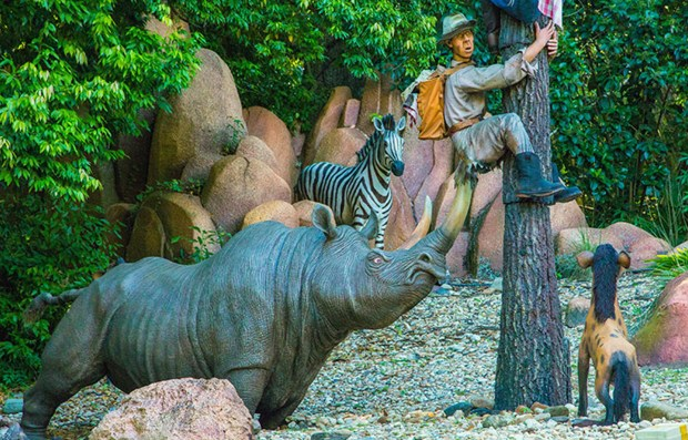 The rhinoceros is getting its point across to the lost safari, a scene on the Jungle Cruise in Adventureland at the Magic Kingdom of Walt Disney World. (Courtesy: The Walt Disney World Resort)