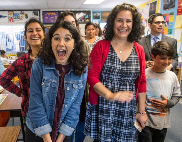 Gianvittoria (cq) Saporito, left, and her mother, Dorene Saporito, right, join other family members as they react while their father/husband, Vincent Saporito is surprised with a 2018 Teacher of the Year award from the Orange County Department of Education in Huntington Beach, California, on Tuesday, May 2, 2017. Saporito, is a special education teacher for the deaf and hard of hearing at College View Elementary School, is one of six teachers who were surprised with the honor by county superintendent of school Dr. Al Mijares. (Photo by Jeff Gritchen, Orange County Register/SCNG)