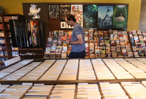Robert Hayden, of Redlands, heads to the cashier with a hand full of comic books at A Shop Called Quest in Redlands on Wednesday, May 3, 2017. The store is getting ready for Saturday's Free Comic Book Day.(Stan Lim, Redlands Daily Facts/SCNG)