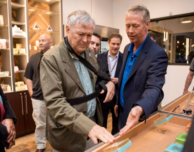 "Rep. Dana Rohrabacher, left, gets a tour of Bud and Bloom dispensary from Kyle Kazan, a partner and board member, in Santa Ana on Friday, May 5, 2017 during a ""meet and greet"" and Cinco del Mayo celebration at the dispensary. (Photo by Leonard Ortiz, Orange County Register/SCNG)"
