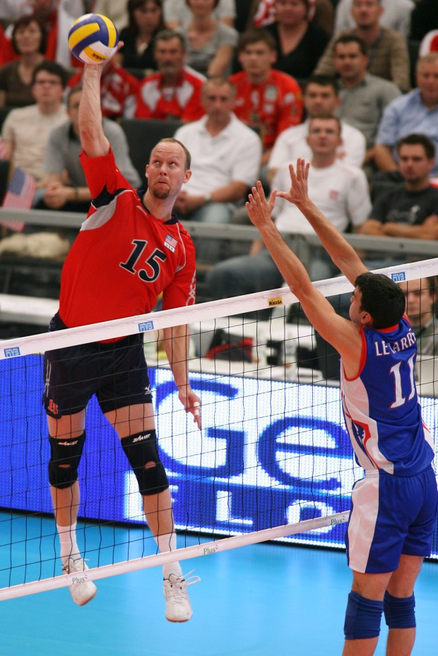 Gabe Gardner, left, of USA spikes against Le Marrec of France. Gardner is a two-time U.S. volleyball Olympian, winner of a gold medal in 2008.(Courtesy of Friends of San Clemente)
