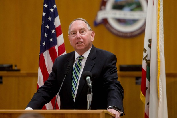 Senator Richard D. Roth, D-Riverside, speaks during the SB 130 signing ceremony at Jurupa Valley City Hall on May 12.