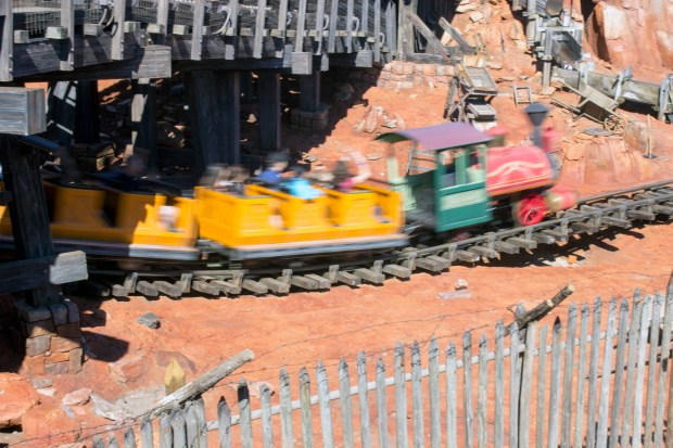 The train is a blur as it speeds under a trestle on the Big Thunder Mountain Railroad in Frontierland at the Magic Kingdom of Walt Disney World. (Photo by Mark Eades, Orange County Register/SCNG)