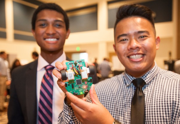Jonathan Hightower, left and Allen Abad display their micromouse, an autonomous maze- solving robot, at the Engineering & Computer Science Student Projects Showcase and Awards on Monday, May 8,. (Photo by Sam Gangwer, Orange County Register/SCNG)