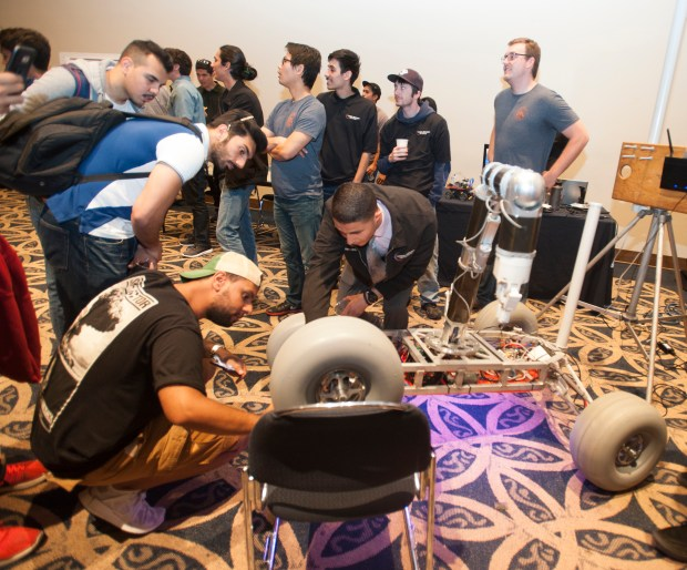 The Titan Rover draws a big crowd of observers at the Engineering & Computer Science Student Projects Showcase and Awards at the Titan Student Union on Monday, May 8, with more than 50 teams of Cal State Fullerton students.. (Photo by Sam Gangwer, Orange County Register/SCNG)