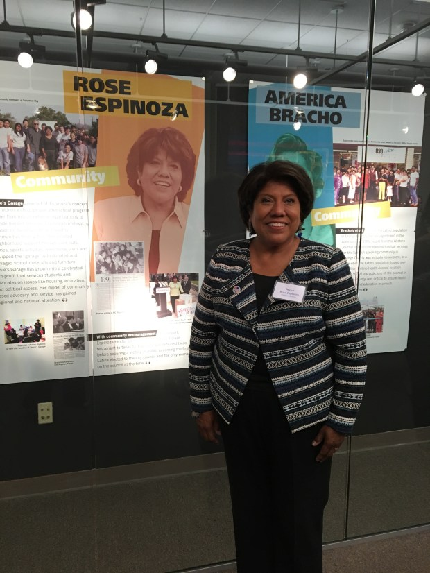 Rose Espinoza of Rosie's Garage in the exhibit space at Cal State Fullerton. (Photo courtesy of Cal State Fullerton)