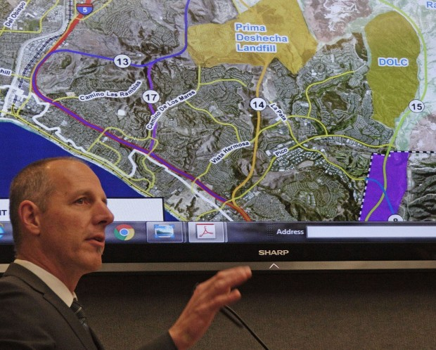 Tom Bonigut, San Clemente official, explains lines on a mobility study map, focusing on three possible 241 tollway extensions shown as routes 13, 17 and 14. Route 15, also under study, would run through sensitive San Onofre land virtually rendered unfeasible by a TCA lawsuit settlement.