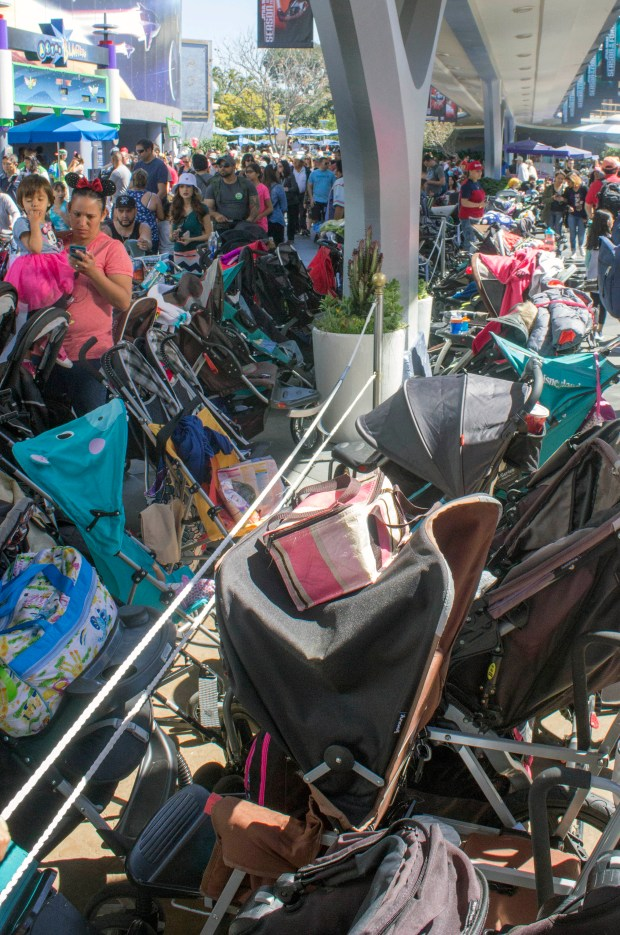 The rows of strollers in Tomorrowland at Disneyland parked between the Star Tours and Buzz Lightyear attractions stretch nearly as far as can be seen, and block off some of the walking area in the land, frequently making it very congested. (Photo by Mark Eades, Orange County Register/SCNG)