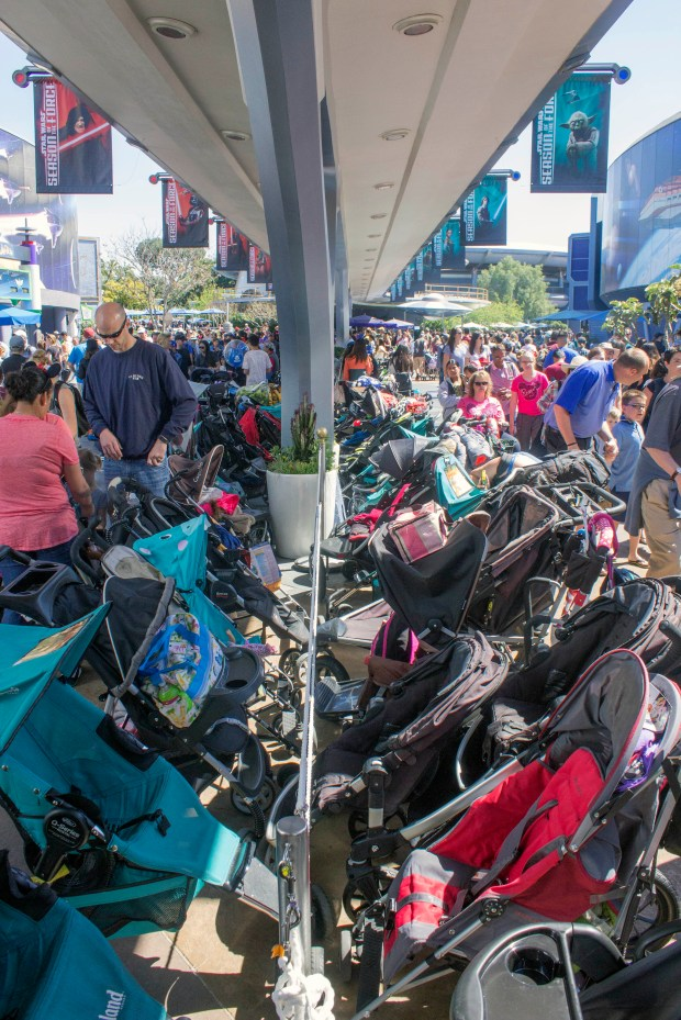 A sea of parked strollers beneath the old Peoplemover and Rocket Rods tracks in Tomorrowland at Disneyland. (Photo by Mark Eades, Orange County Register/SCNG)