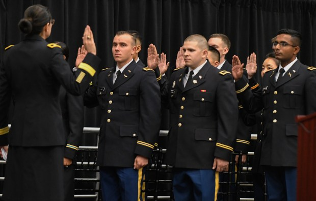 Brig. Gen. Marion Garcia, left, recites the officers' oath to the graduating class at the commissioning ceremony for the Cal State Fullerton Army ROTC (Titan Battalion) held in the Titan Gym on May 19. (Michael Kitada Contributing Photographer)