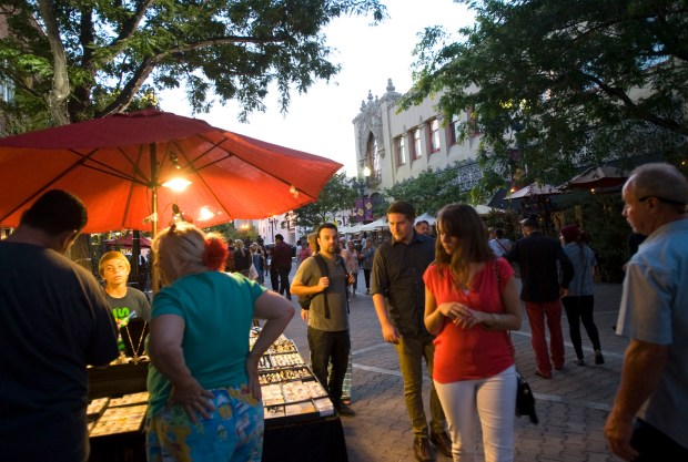 First Saturday Artwalk in downtown Santa Ana enables you to visit 20 galleries and see artists creating their work. (Photo by Ana Venegas, Orange County Register/SCNG)