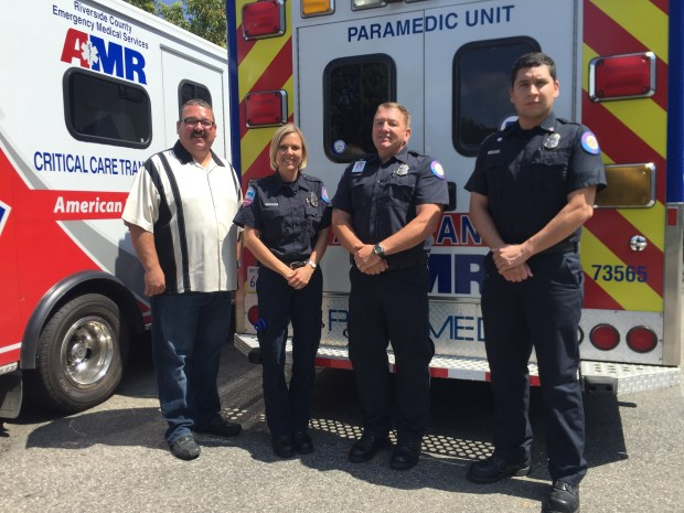 American Medical Response firefighters, from left, James Meyer, Lisa De Metz, Christopher Brown and Rafael Blanco are being recognized for their service. Photo by Alejandra Molina, Staff
