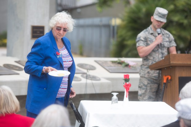 From left, Auxiliary Jr. Vice President Bernice Francis and SSGT U.S. Air Force Sterling Koliba conduct the POW/MIA Honors ceremony during Memorial Day in Fountain Valley on Monday, May 29, 2017. (Photo by Drew A. Kelley, Contributing Photographer)