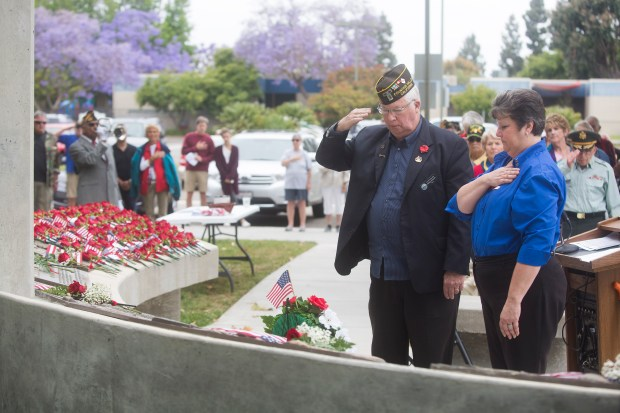 From right, Auxiliary Treasurer Joyce Daniels and Mayor John Collins place a wreath at the base of the Fountain Valley Veterans Memorial during a Memorial Day Ceremony on Monday, May 29, 2017. (Photo by Drew A. Kelley, Contributing Photographer)