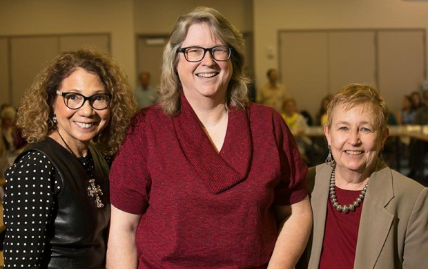 Cal State Fullerton biological science professor Merri Lynn Casem, center, received a standing ovation from her peers, including President Mildred García and Emily Bonney, chair of CSUF's Academic Senate. (Photo courtesy of Cal State Fullerton)