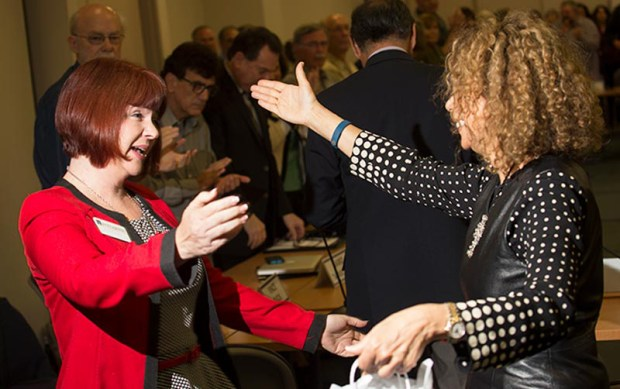 Cal State Fullerton President Mildred Garcia, right, congratulates alum Shelli Wynants on being named this year's Outstanding Lecturer Award recipient. (Photo courtesy of Cal State Fullerton)