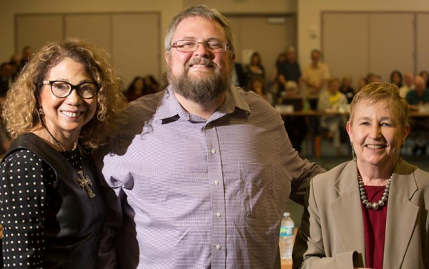 President Mildred Garcia, left, and Academic Senate Chair Emily Bonney congratulate Sean Walker, center, as the 2016-17 recipient of the Faculty Leadership in Collegial Governance Award. (Photo courtesy of Cal State Fullerton)