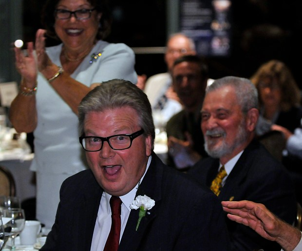 Tustin Man of the year John McGuire is surprised after his name is announced Friday, June 10, 2016 in Tustin.///ADDITIONAL INFO: manandwomanofyear5--- 06/10/16 -- MICHAEL FERNANDEZ, FOR THE REGISTER