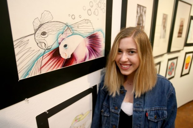 "Orange Lutheran High School student Brooklynn Scantlebury poses next to her mixed media art piece, ""Beta Fish,"" during the Artist Village Art Walk at the Santa Ana College Santora Arts Building on Saturday night, June 03, 2017. High school students are invited by Santa Ana College to show their work in a formal art gallery setting throughout the month of June. (Photo by Ana P. Gutierrez-Garcia, Contributing Photographer)"