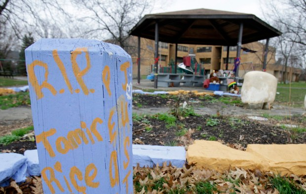 "FILE – In this Dec. 29, 2015, file photo, ""R.I.P. Tamir Rice"" is written on a wooden post near a makeshift memorial at the gazebo where the boy was fatally shot, outside the Cudell Recreation Center in Cleveland. Cleveland Police Chief Calvin Williams announced Tuesday, May 30, 2017, that Timothy Loehmann, the police officer who shot and killed the 12-year-old boy, has been fired for inaccuracies on his job application, while the officer who drove the patrol car the day of the Nov. 22, 2014, shooting, Frank Garmback, has been suspended for 10 days for violating a tactical rule for his driving that day. (AP Photo/Tony Dejak, File) ORG XMIT: OHPX205"