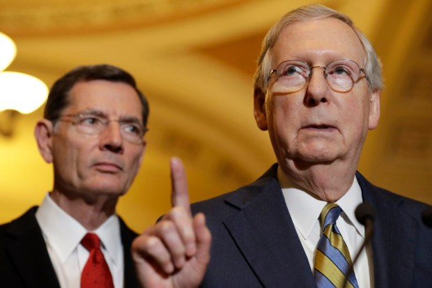 Senate Majority Leader Mitch McConnell of Ky., right, accompanied by Sen. John Barrasso, R-Wyo., meets with reporters on Capitol Hill in Washington, Tuesday, May 23, 2017, following after a Republican policy luncheon. (AP Photo/Jacquelyn Martin) ORG XMIT: DCJM203
