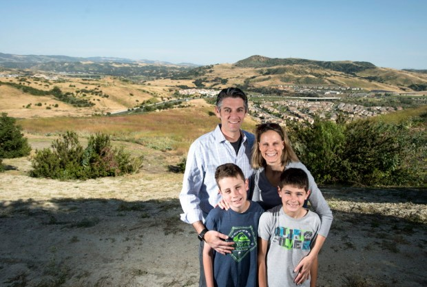 Jeff Braunstein of Ladera Ranch, with his wife Pamela, and sons Zane and Rhys oppose the option that would extend 241 Toll Road behind his house. (Photo by Kyusung Gong/Orange County Register/SCNG)