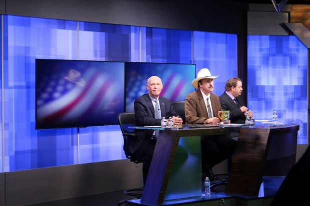 FILE - In this April 29, 2017, file photo, three candidates, from left, Republican Greg Gianforte, Democrat Rob Quist and Libertarian Mark Wicks vying to fill Montana's only congressional seat await the start of their only televised debate in Great Falls, Mont. Montana voters are heading to the polls Thursday, May 25, 2017, to decide a nationally watched congressional election amid uncertainty in Washington over President Donald Trump's agenda and his handling of the country's affairs. (AP Photo/Bobby Caina Calvan, file) ORG XMIT: PDX308