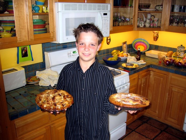 A decade ago, son Matt Goulding shows off his pies in our never-changing kitchen. (Photo by Michael Goulding)