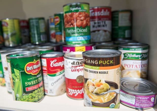 Various canned good fill the Blessing Box outside the Whitten Community Center in Placentia, on Tuesday, May 23, 2017. Community members are encouraged to leave extra food and take food they need. (Photo by Nick Agro, Orange County Register/SCNG)
