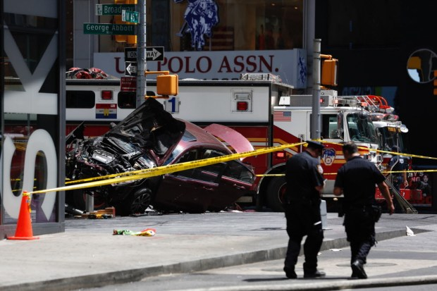 A smashed car sits on the corner of Broadway and 45th Street in New York's Times Square after ploughing through a crowd of pedestrians at lunchtime on Thursday, May 18, 2017. Police do not suspect a link to terrorism and the driver was taken into custody to be tested for alcohol. (AP Photo/Seth Wenig) ORG XMIT: NYAJ404