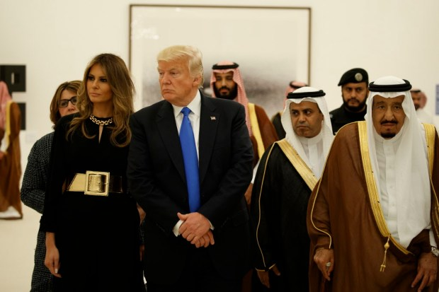 FILE - In this May 20, 2017 file photo, President Donald Trump and first lady Melania Trump visit an art exhibit with Saudi King Salam at the Royal Court Palace in Riyadh. (AP Photo/Evan Vucci, File) ORG XMIT: WX103