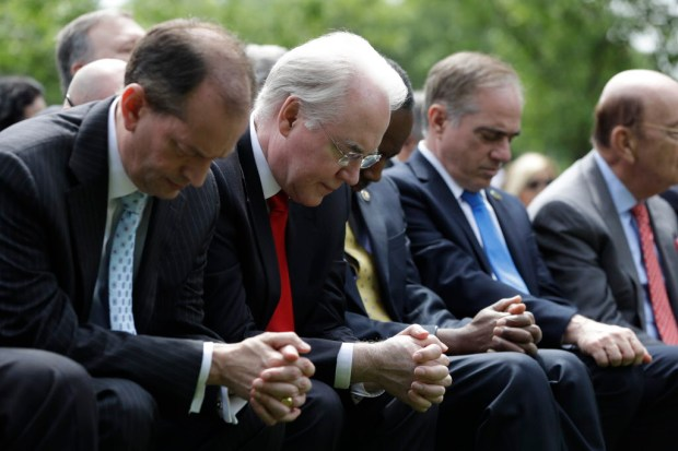 From left, Labor Secretary Alexander Acosta, Health and Human Services Secretary Tom Price, Housing and Urban Development Secretary Ben Carson, Veterans Affairs Secretary David Shulkin and Commerce Secretary Wilbur Ross pause in the Rose Garden of the White House in Washington, Thursday, May 4, 2017, prior to President Donald Trump signing an executive order aimed at easing an IRS rule limiting political activity for churches. (AP Photo/Evan Vucci) ORG XMIT: DCEV202 ORG XMIT: RIV1705040838215476
